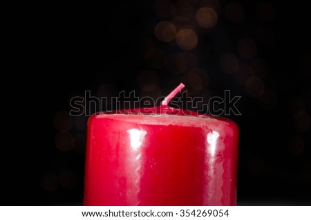 Red candle with fire against defocused lights #354269054