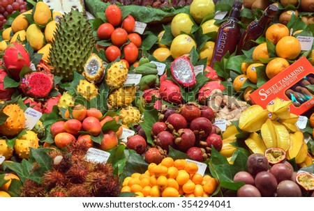 BARCELONA, SPAIN - September 29: Organic Fruits in market on September 29, 2015 in Barcelona, Spain. Famous La Boqueria market / photography of the variety of fruits at the market. #354294041