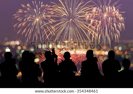 The silhouette of reporter photograph the Fantastic festive new years colorful fireworks on cityscape blurred photo bokeh,project success, holiday concept #354348461