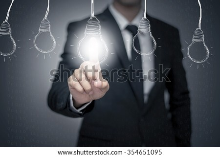 businessman pressing button with bulb on virtual screen #354651095