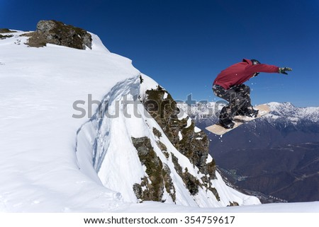 Flying snowboarder on mountains. Extreme winter sport. #354759617