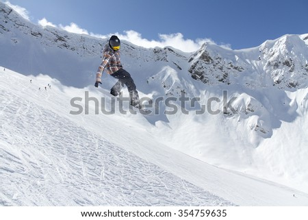 Flying snowboarder on mountains. Extreme winter sport. #354759635