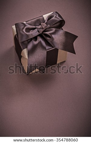 Giftbox on brown surface vertical view holidays concept. #354788060