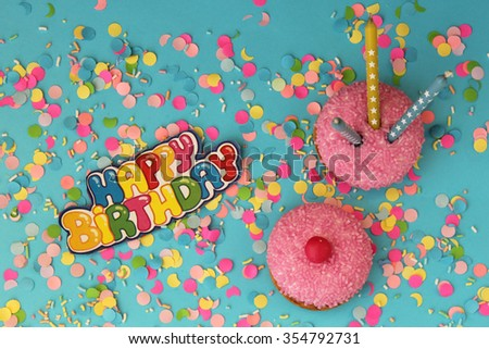 Cupcake on blue confetti background - happy birthday card
