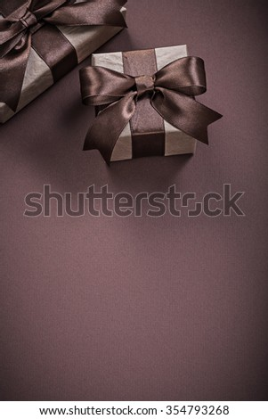 Christmas gift boxes on brown background holidays concept. #354793268