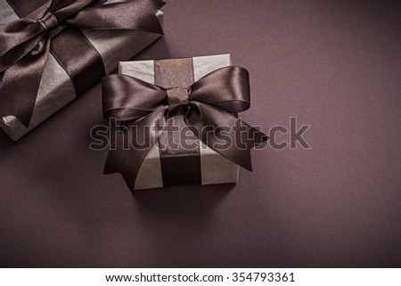 Christmas present boxes on brown background holidays concept. #354793361