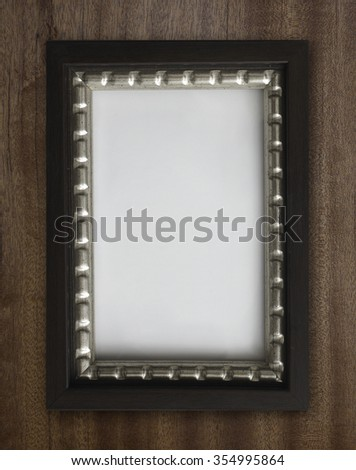 Vintage  and blank photo frame on old wooden background #354995864