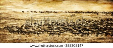 Vanishing Africa: vintage style image of a Blue Wildebeest herd in the Maasai Mara National Park in Kenya