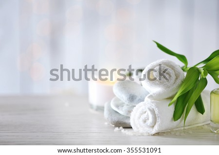 Beautiful composition of spa treatment on wooden table #355531091