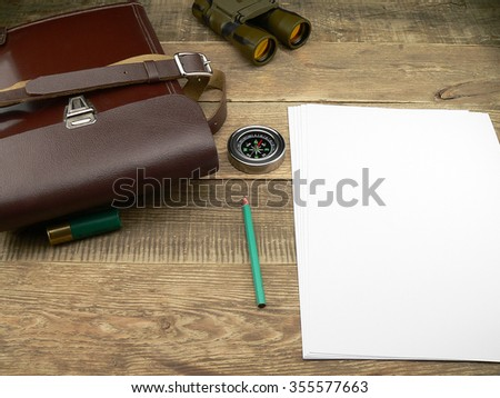 Hunting, war, ammunition and compass on a wooden background #355577663