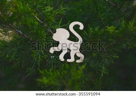 Spruce, arborvitae, park, monkey, symbol, Chinese New Year, wood #355591094