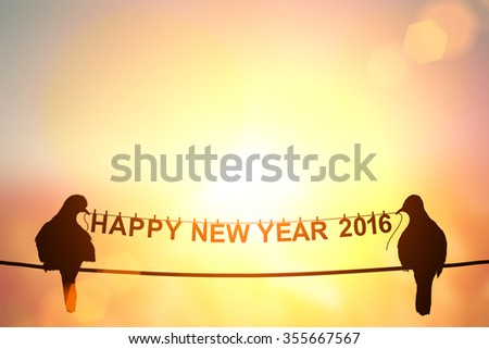 """Love Concept with bird silhouette in """"Happy new year 2016 """" text  on pastel background."""