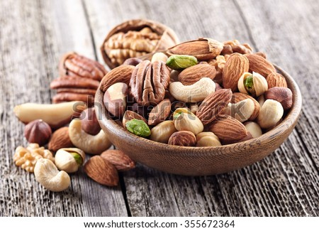 Nuts mix in a wooden plate #355672364