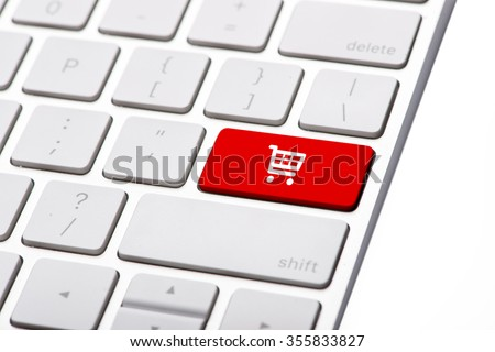 online shopping or internet shop concepts, with shopping cart symbol. Shop online business concept. Red shopping cart button or key on white keyboard #355833827