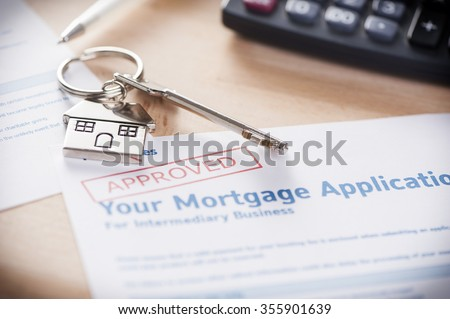 Approved mortgage loan agreement application with house shaped keyring #355901639