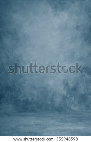 Painted canvas or muslin fabric cloth studio backdrop or background, suitable for use with portraits, products and concepts. Romantic strokes of blue shades. Royalty-Free Stock Photo #355948598