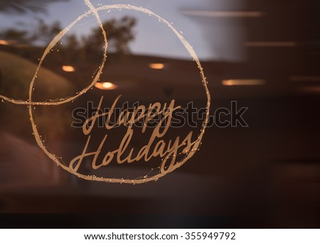 Happy Holidays sign glows across a window background around New Years eve #355949792