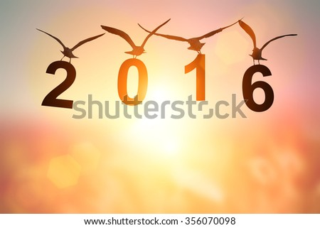 """Love Concept with bird silhouette in """" 2016 """" text on pastel background. Happy new year 2016"""