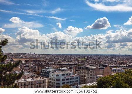PARIS, FRANCE - AUGUST 30, 2015: View from Montmartre to summer Paris and beautiful blue sky with soft clouds. Paris, France. #356132762