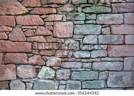 Old stone wall with different size of rock  #356144342