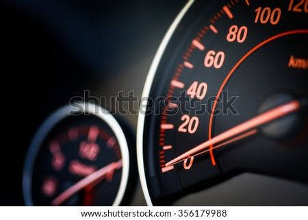 Close up shot of a speedometer in a car. Royalty-Free Stock Photo #356179988