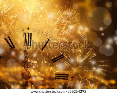 New Year's at midnight - Old clock with fireworks and holiday lights #356254292