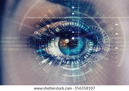 Close up of woman eye in process of scanning Royalty-Free Stock Photo #356358107