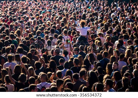 MADRID - SEP 12: Crowd in a concert at Dcode Festival on September 12, 2015 in Madrid, Spain. #356534372