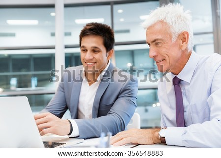 Two businessmen in fornt of computer in office #356548883