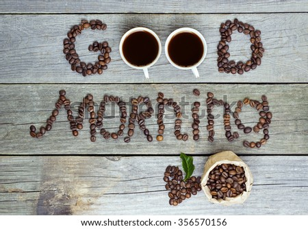 good morning concept - coffee beans, Cup of black coffee, heart from coffee beans, coffee leaves. Toned, selective focus image. lovely message