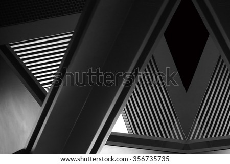 Double exposure close-up of modern architecture fragment. Realistic but nor real photo  of interior details appeared in superposition of shots. Abstract composition with complex geometric structure. Royalty-Free Stock Photo #356735735