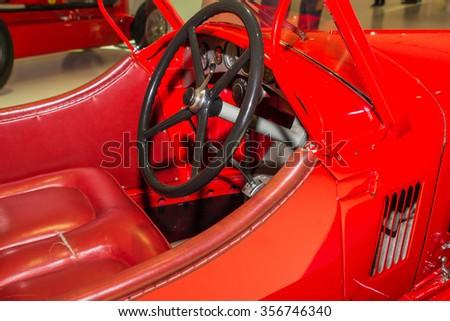 MODENA, ITALY - APRIL 2015: Museum Enzo Ferrari Modena. Red Alfa Romeo 8C 2300 Spider Corsa 1932 with the symbol of Alfa Romeo on. View of car cabin. #356746340