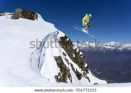Flying skier on mountains. Extreme winter sport. #356772155