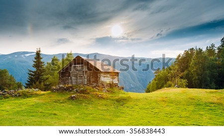 Old abandoned wooden house on a background of the Norwegian mountains. Summer nature Norway. Panoramic view #356838443