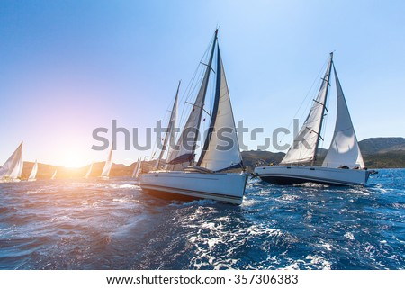 Luxury yachts at Sailing regatta. Sailing in the wind through the waves at the Sea.  Royalty-Free Stock Photo #357306383