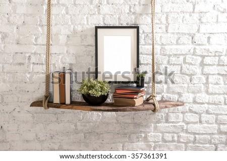 brick wall  drift wood shelves and frame concept decor   #357361391
