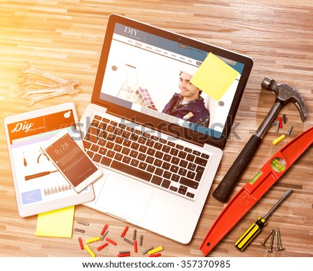View of a Wood handyman's desk in high definition with laptop, tablet and mobile #357370985