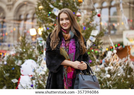 Young beautiful woman in stylish mink coat on a background of a winter street #357396086