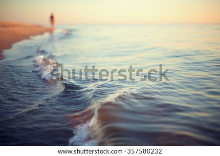 beach sunset abstract background shoreline close up stylized Royalty-Free Stock Photo #357580232