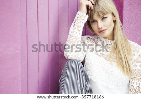 Beautiful boho lady in portrait against pink wall Royalty-Free Stock Photo #357718166