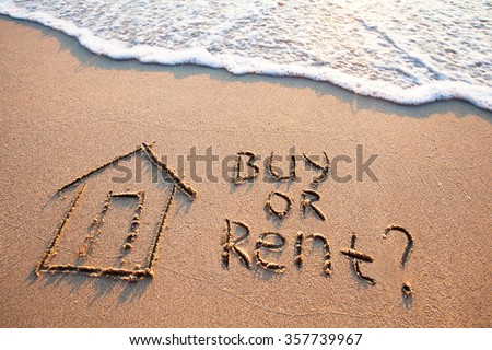 buy or rent concept, text on the sand, real estate