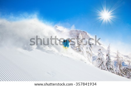 Skier skiing downhill in high mountains #357841934