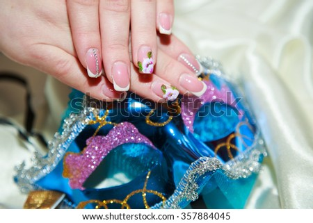 manicure on a carnival mask #357884045