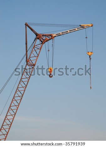 Tower crane with steel hook building metal construction #35791939