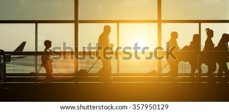 Passengers silhouettes at the airport. Concept about travels and transportation #357950129