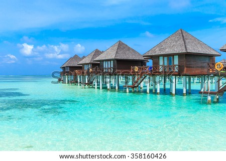 beach with water bungalows at Maldives #358160426