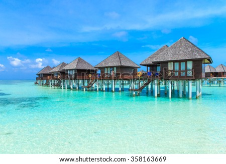 beach with water bungalows at Maldives #358163669
