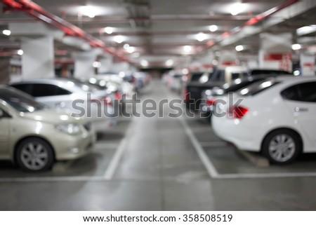 Blur image, Underground parking with cars. #358508519