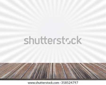 Wood table top on gray sunburst background.   can be used for display or montage your products