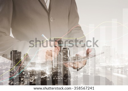 Double exposure of success businessman using digital tablet with financial graph on blurred city landscape background, Business Trading concept  #358567241